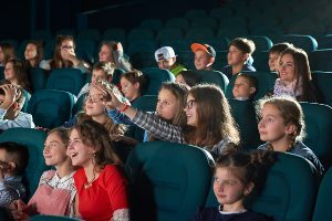 Kids at a theater watching a show